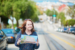 Happy young woman on a street of Can Francisco Royalty Free Stock Photos
