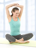 Happy Young Woman Stretching Arms On Yoga Mat Stock Photography