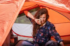 Happy young woman stretching relax at tent. Happy young woman stretching relax at red tent stock image