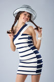 Happy young woman in the striped Royalty Free Stock Photo