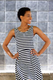 Happy young woman in striped dress Royalty Free Stock Photo