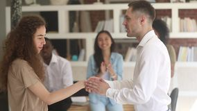 Happy woman worker student get rewarded promoted handshake boss teacher. Happy young woman student intern worker appreciated rewarded promoted handshake male stock video footage
