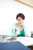 Happy young woman studying Stock Images