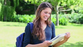 Happy young woman studying Royalty Free Stock Photo