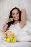 Happy young woman with sugar candy Royalty Free Stock Image