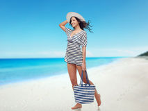 Happy young woman in summer clothes and sun hat Stock Photography