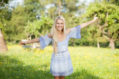 Happy young woman on a summer flower meadow outdoor Stock Images