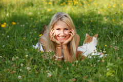 Happy young woman on a summer flower meadow outdoor stock image