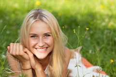Happy young woman on a summer flower meadow outdoor royalty free stock photography