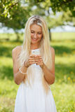 Happy young woman on a summer flower meadow outdoor royalty free stock image