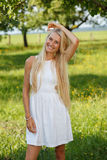 Happy young woman on a summer flower meadow outdoor Stock Photo
