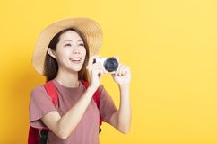 Happy young woman in summer hat and holding camera stock images