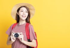 Happy young woman in summer hat and holding camera royalty free stock image