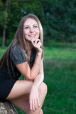 Happy young woman in the summer park Royalty Free Stock Images