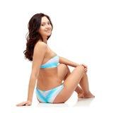 Happy young woman sunbathing in bikini swimsuit Royalty Free Stock Photo