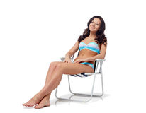 Happy young woman sunbathing in bikini swimsuit Stock Images