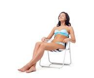 Happy young woman sunbathing in bikini swimsuit Royalty Free Stock Photography