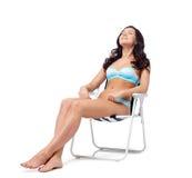 Happy young woman sunbathing in bikini swimsuit Royalty Free Stock Image