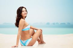 Happy young woman sunbathing in bikini swimsuit Royalty Free Stock Images