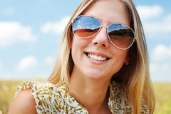 Happy young woman in sunglasses Stock Images