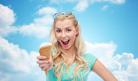 Happy young woman in sunglasses eating ice cream Royalty Free Stock Images