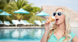 Happy young woman in sunglasses eating ice cream Stock Images