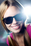 Happy young  woman with sunglasses looking at the camera Royalty Free Stock Photos