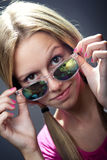 Happy young  woman with sunglasses looking at the camera Royalty Free Stock Photography