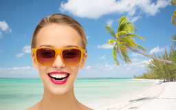 Happy young woman in sunglasses with pink lipstick Royalty Free Stock Photography