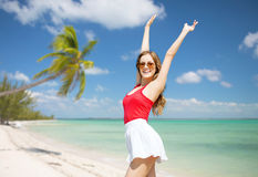 Happy young woman in sunglasses on summer beach Royalty Free Stock Photography