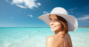 Happy young woman in sunhat over summer beach Royalty Free Stock Images