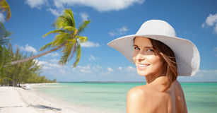 Happy young woman in sunhat over summer beach Stock Photos