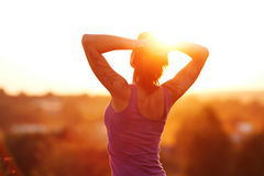 Happy young woman at sunset Royalty Free Stock Photo