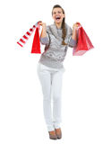 Happy young woman in sweater with christmas shopping bags Royalty Free Stock Photos