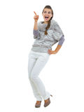 Happy young woman in sweater pointing on copy space Stock Photo
