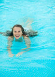 Happy young woman swimming in pool Royalty Free Stock Images