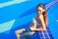 Happy young woman in swimming pool Stock Photo