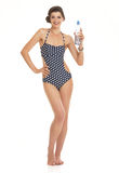 Happy young woman in swimsuit with bottl Royalty Free Stock Photography