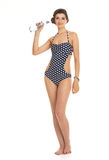 Happy young woman in swimsuit with bottl Royalty Free Stock Images