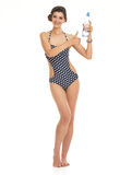 Happy young woman in swimsuit with bottl Royalty Free Stock Photo