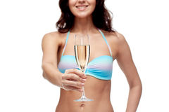 Happy young woman in swimsuit drinking champagne Stock Images