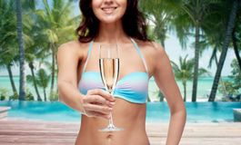 Happy young woman in swimsuit drinking champagne Royalty Free Stock Image