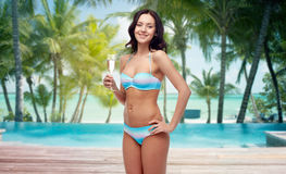 Happy young woman in swimsuit drinking champagne Stock Image