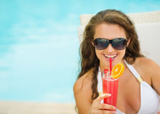 Happy young woman in swimsuit drinking cocktail Royalty Free Stock Images