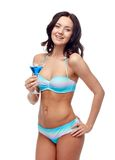 Happy young woman in swimsuit drinking cocktail Royalty Free Stock Photo