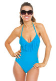 Happy young woman in swimsuit and eyeglasses Royalty Free Stock Photo