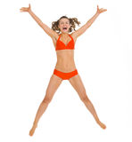 Happy young woman in swimsuit jumping Stock Photography