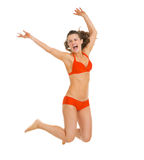 Happy young woman in swimsuit jumping Stock Photos