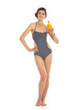 Happy young woman in swimsuit showing bo Stock Images