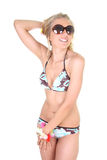Happy young woman in swimsuit and sunglasses Royalty Free Stock Image